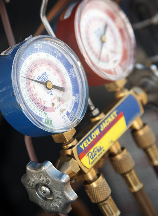 refrigerant-gauges-being-used-by-HVAC-technician